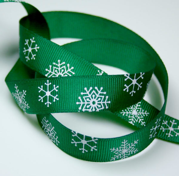 3 meters of 14 mm Grosgrain Green Ribbon with Snowflakes