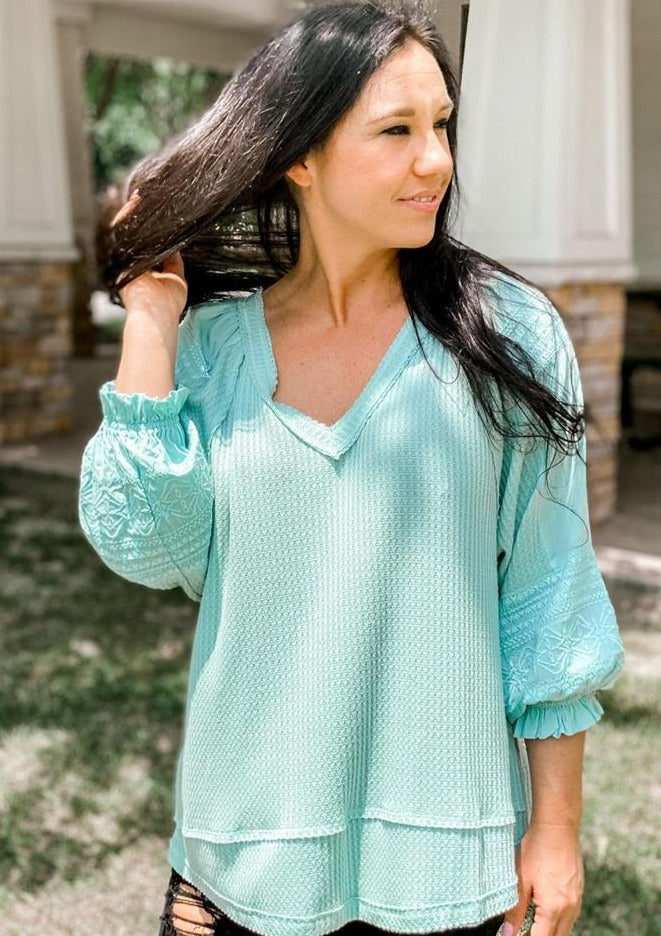 sea-foam green waffle knit shirt with embroidered sleeves