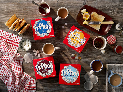 Typhoo range on a table with cups of tea and breakfast foods
