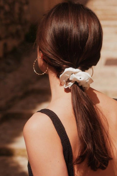 low ponytail hair scrunchies hairstyle