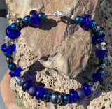 Gorgeous deep blue with hematite and skull beads