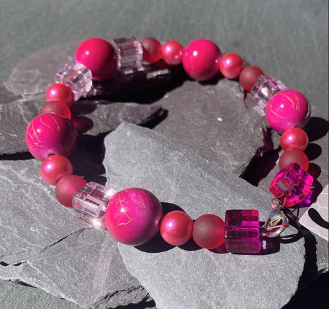 Fuscia pink bracelet with glass and acrylic beads