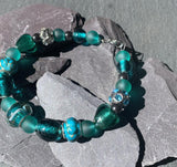 Striking Murano glass and charm bracelet