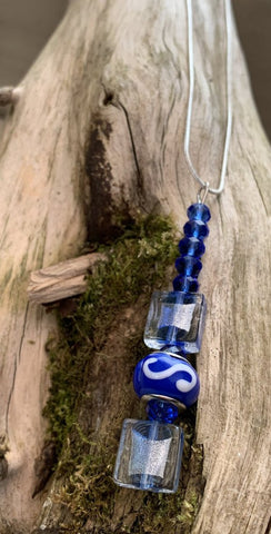 Bright blue glass beaded pendant
