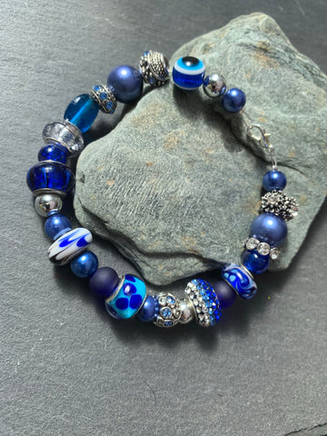 Bright blue and charm bead bracelet