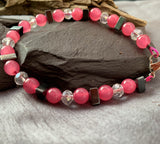 Pink jade and hematite triangles