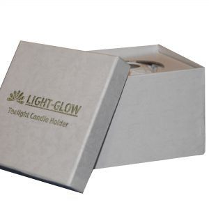 Light glow tea light holder boxed.