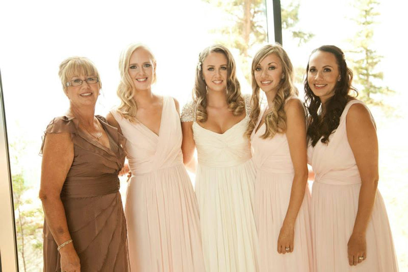 real reem acra bride wearing olivia wedding dress and blush pink bridesmaids