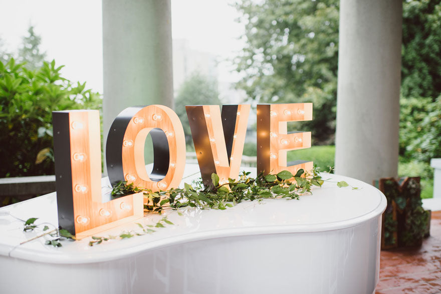 love marquee lights sign at hycroft manor outdoor wedding