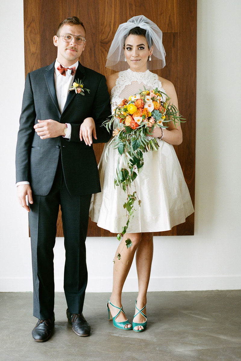 60's vintage inspired bride with short puffy veil