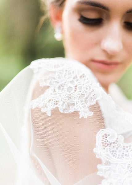 close up of bride and chantilly lace on veil