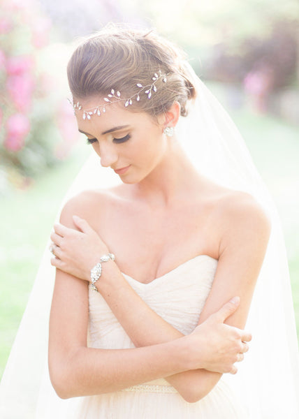 bride wearing crystal hair vine and crystal vintage-inspired bracelet