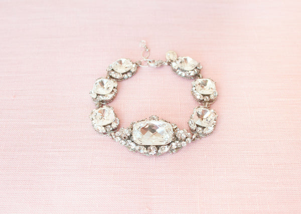 close up of haute bride crystal vintage-inspired bridal bracelet with art deco brooch accents