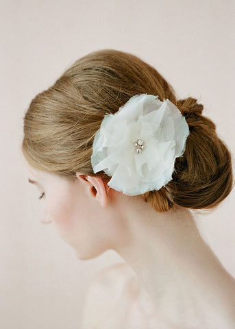 wedding hair with fabric flower with crystal center.