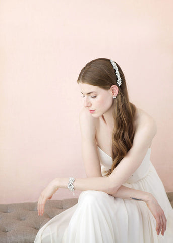 Crystal studs wedding side swept hairstyle