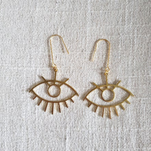 Load image into Gallery viewer, Large Eye Brass Earrings on woven fabric
