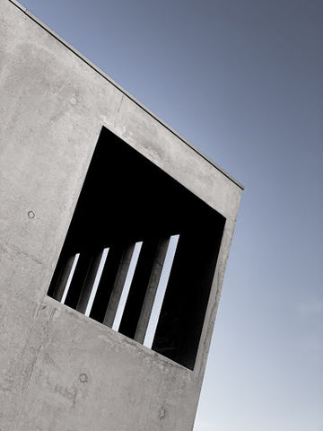 picture of a concrete frame structure on a grey cloudy day