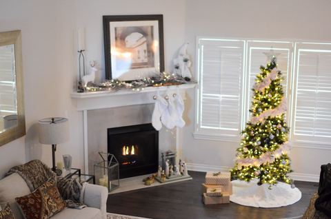 fireplace with Christmas decor surrounding in and around the living area