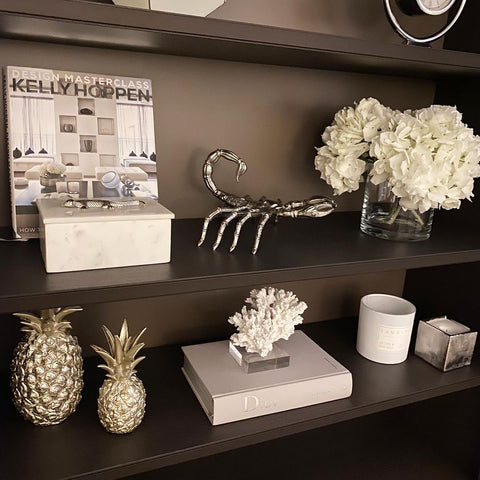 Styling designer coffee table books on bookshelves