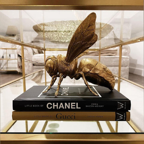 Bee Sculpture in Gold styled with black book