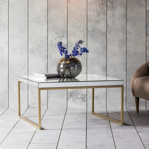 Mirrored top rectangular coffee table with brass legs