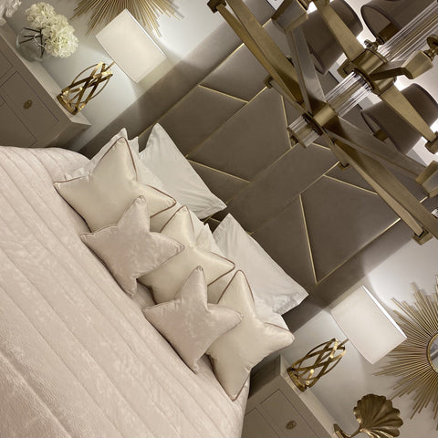Haze cream textured cushions in a warm palette bedroom