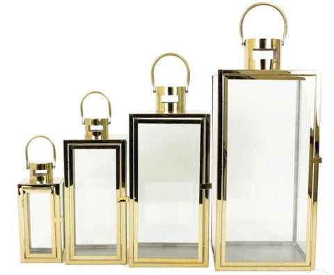 Four multi sized gold lanterns