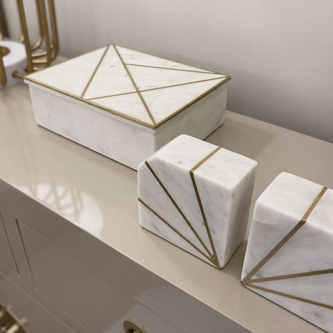 Marble trinket box and bookends with gold metal geometric detailing