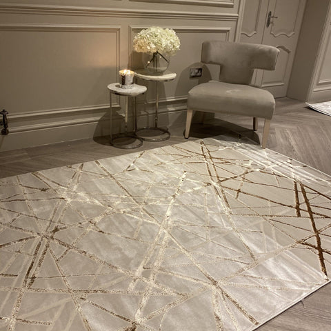 Cream rug with high shine gold scores