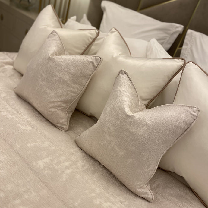 Cream piped cushions with a subtle hammered effect