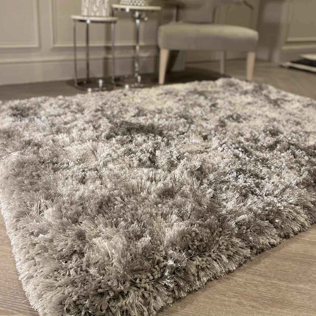 A deep pile rug in silver