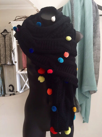 large knitted pom pom scarf