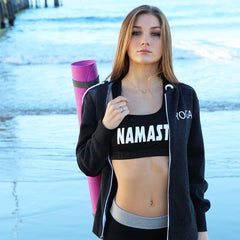 Namaste text on a reversible racerback sports bra