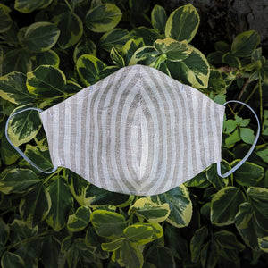 brown and white striped linen face mask