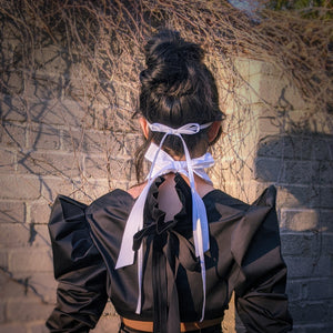 neck and head ties on white cotton face mask with black terno butterfly sleeve bolero jacket