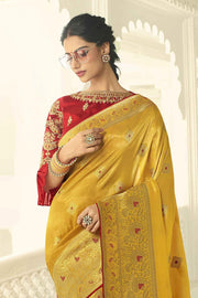 Yellow designer banarasi saree with embroidered silk blouse
