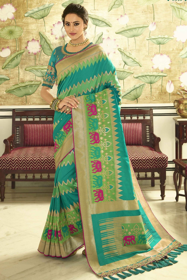 Green designer Banaras saree with embroidered silk blouse