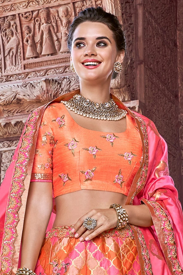SALMON AND CORAL PINK EMBROIDERED SILK LEHENGA WITH EMBROIDERED BLOUSE AND DUPATTA