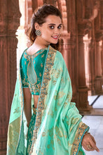 Load image into Gallery viewer, MINT GREEN  EMBROIDERED SILK LEHENGA WITH EMBROIDERED BLOUSE AND DUPATTA