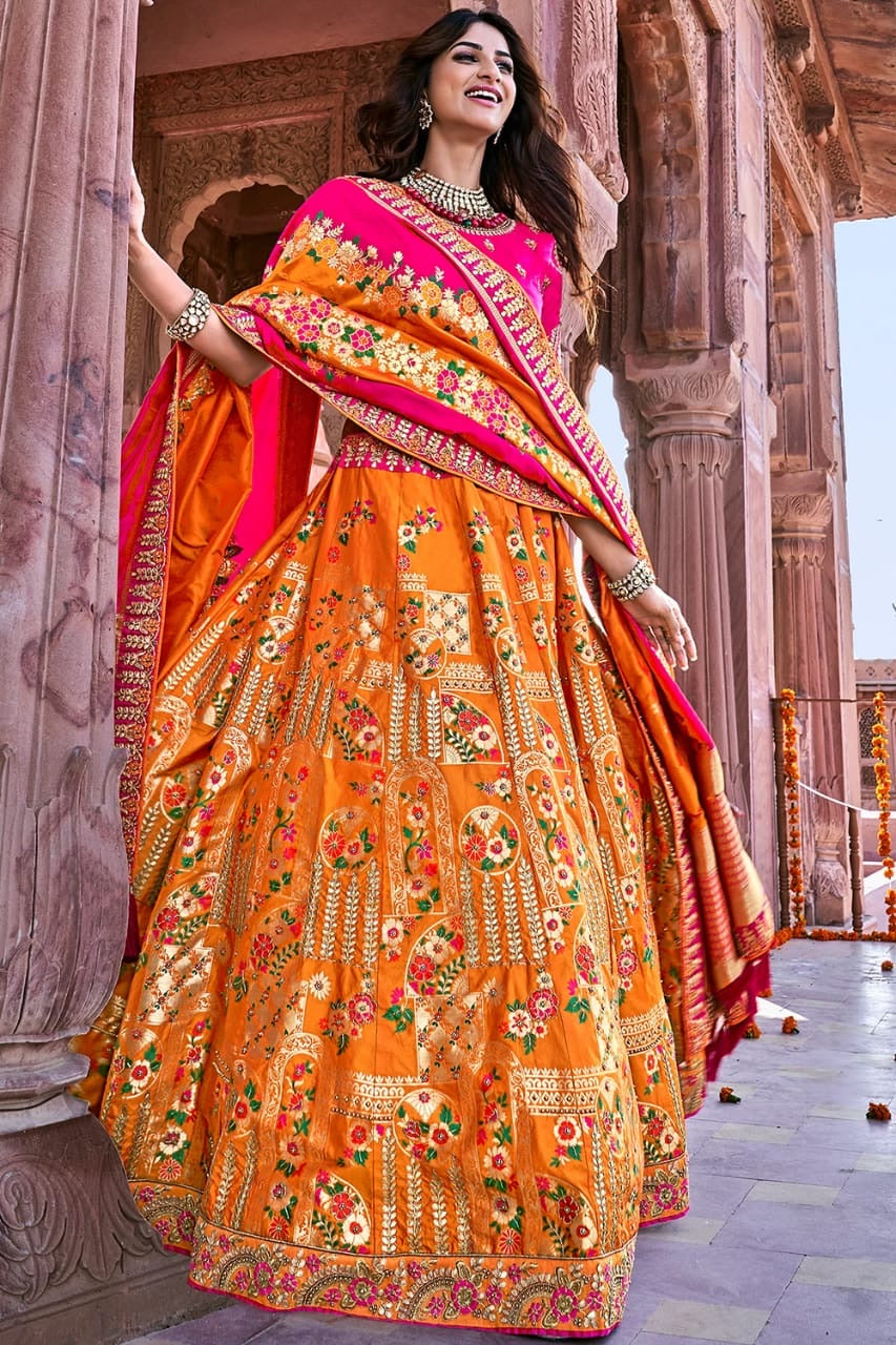 TANGERINE ORANGE EMBROIDERED SILK LEHENGA WITH EMBROIDERED BLOUSE AND DUPATTA