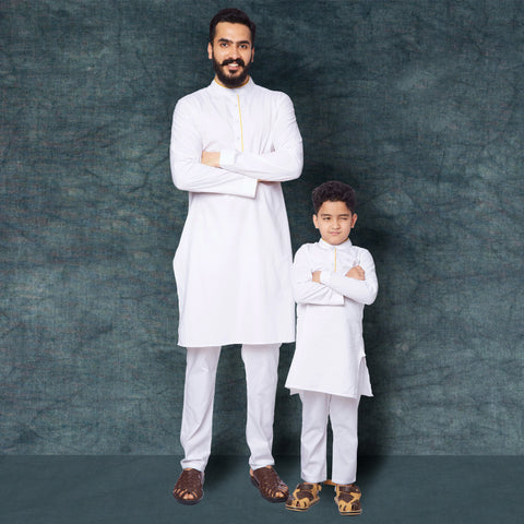 White kurta pyjama set with yellow piping for father son