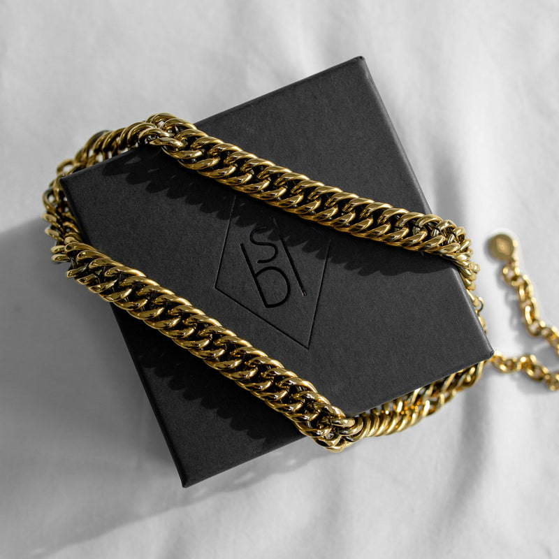 Gold cuban link chain on black jewellery box