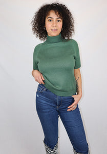 Green turtleneck jumper