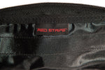 Closeup on logo on the Red Stripe™ Accessory Window Pouch