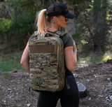 Female model wearing the Red Stripe™ Poseidon Waterproof Dry Bag - MultiCam®
