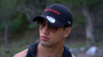 Male model wearing the Red Stripe™ Technical Trucker® Cap