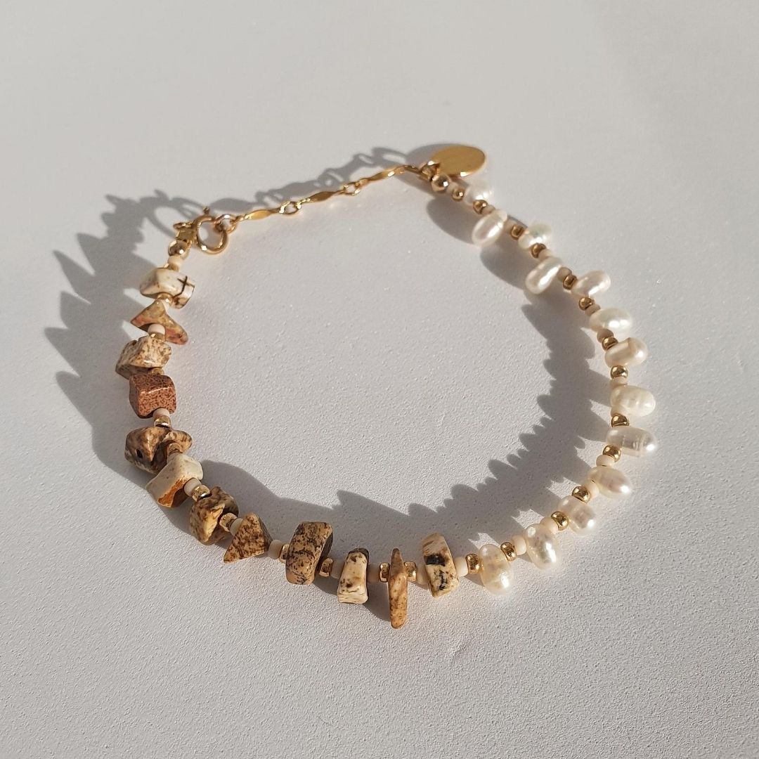 Designed with freshwater pearls, jasper stones, glass seed beads and 14Kt gold-filled beads. A unique, eye-catching design highlighting the perfectly imperfect beauty of these two stunning gemstones.