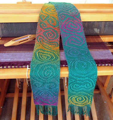 Lisa Rayner's Mermaid scarf, which appeared on the cover of Hand Woven magazine.