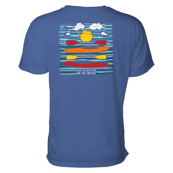In this outdoors t-shirt, two kayaks balance with paddles in the ripples of the water where we see a reflection of the sun as well. Graphic design is colorful and looks almost like a wood print.