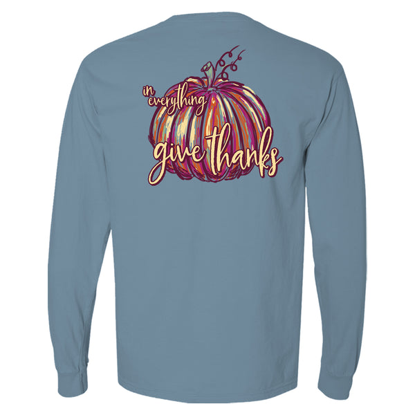 "This cute Thanksgiving t-shirt for women has a colorful orange and pink painterly pumpkin with the words ""In everything give thanks."""